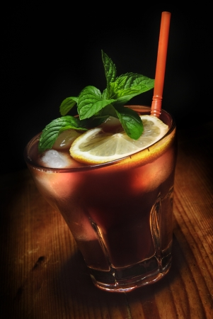 Cuba Libre cocktail on rustic wooden background photo