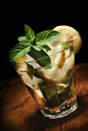 Mojito cocktail on rustic wooden background photo