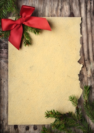 Christmas decoration and vintage paper on wooden background Stock Photo