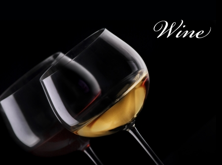 Glass of red and white wine on black background photo