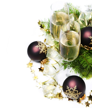 Two champagne glasses and christmas ornaments