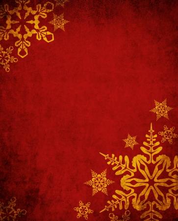 Noël fond rouge avec des flocons de neige d'or Banque d'images