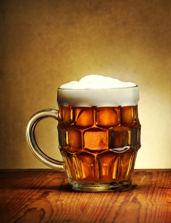 Beer mug on rustic wooden table photo