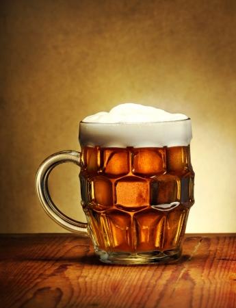 Beer mug on rustic wooden table Stock Photo - 16374265