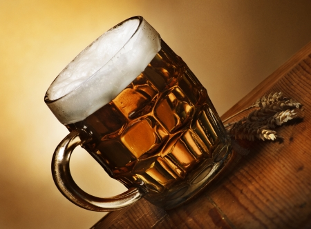 foam party: Beer mug on rustic wooden table