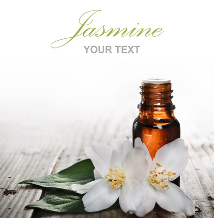 essential oil: Essential oil with jasmine flower on wooden plank