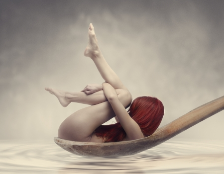body milk: Red haired woman in wooden spoon  Fantasy concept