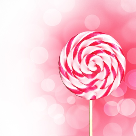 Pink lollipop design with copyspace Фото со стока
