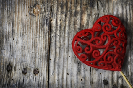 Valentine heart on rustic wooden background