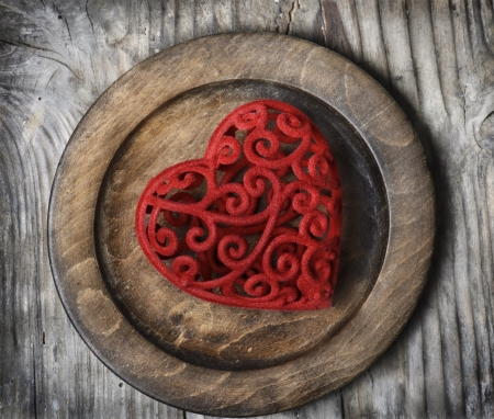 Valentine heart in vintage wooden plate Stock Photo - 17585222