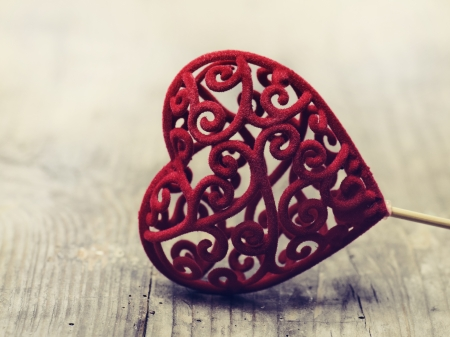 Valentine heart on rustic wooden background photo