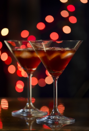 Red cocktail in martini glasses photo