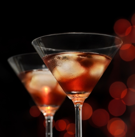 Red cocktail in martini glasses