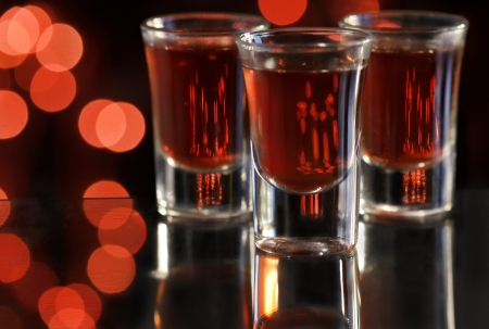 Red cocktail in shot glasses photo