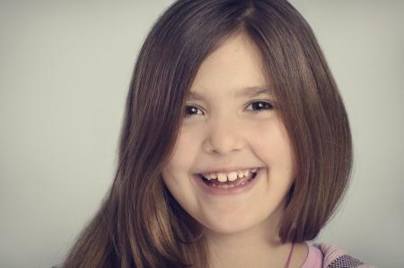 Portrait of beautiful smiling little girl photo