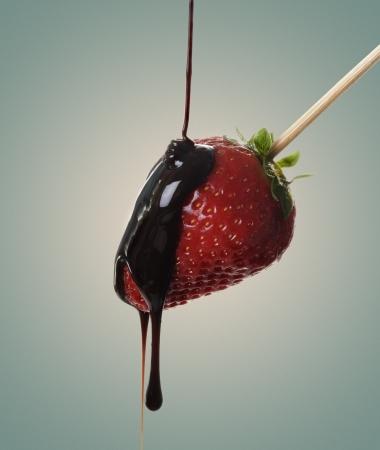 strawberry chocolate: Pouring chocolate over fresh yummy strawberry