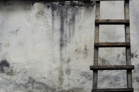 Old ladders on rustic dirty wall photo