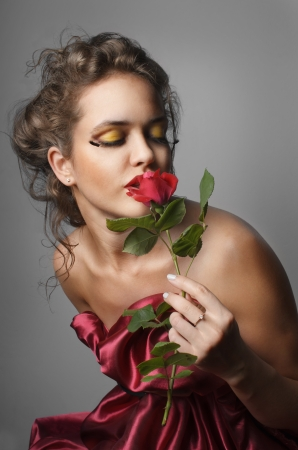 Beautiful young woman with red rose Stock Photo - 19761498