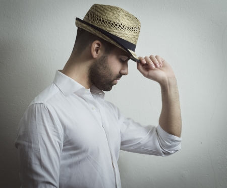 Young attractive man with modern hat photo