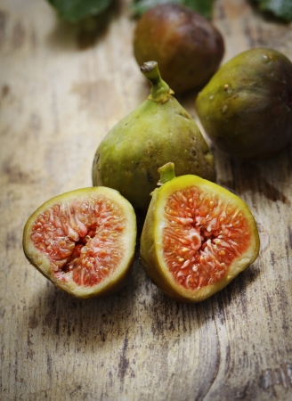 purple fig: Sliced fig on rustic wooden table