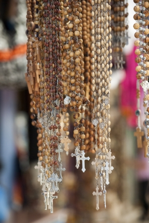 Crucifix hanging in souvenir shop in front of the church of the holy Sepulchre in Jerusalem photo