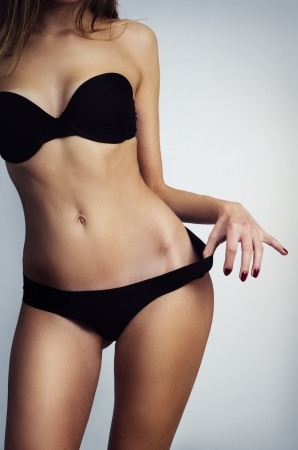 Perfect female torso in black lingerie