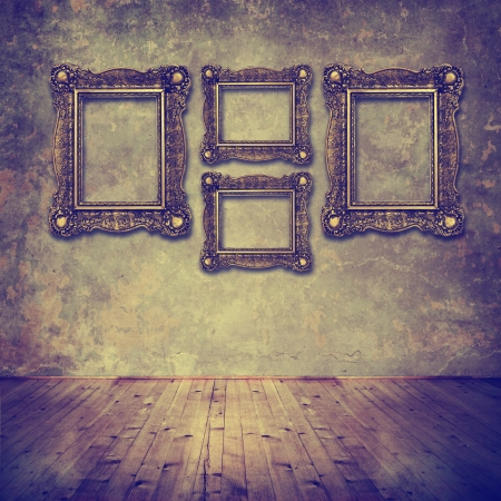ancient home interior vintage golden frames on grunge wall stock photo