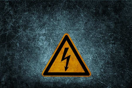 High voltage danger sign on dirty grunge wall background photo