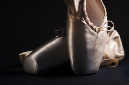 pointe: Pointe shoes over black background