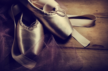 ballet slipper: Pointe shoes on wooden background Stock Photo