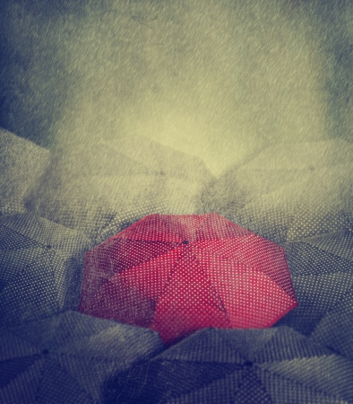 red umbrella: Artistic image of red umbrella standing out from the crowd