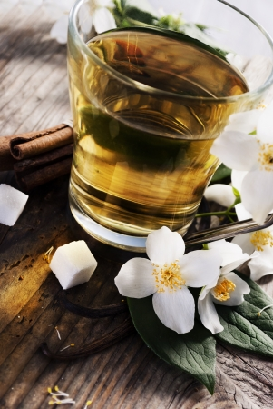 Cup of jasmine tea on wooden table photo