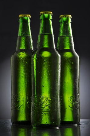 Wet beer bottles on black  background Stock Photo - 25311209