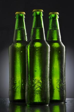 Wet beer bottles on black  background Stock Photo - 25311209