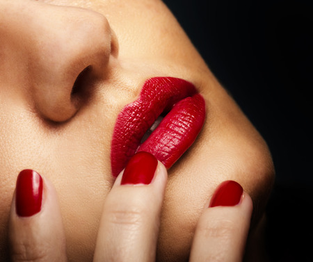 lipstick kiss: Beautiful female lips with red lipstick Stock Photo