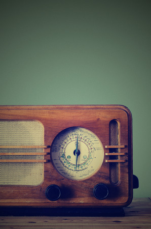 Antique radio on retro background photo