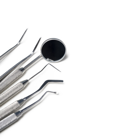 Dental instruments closeup isolated over white