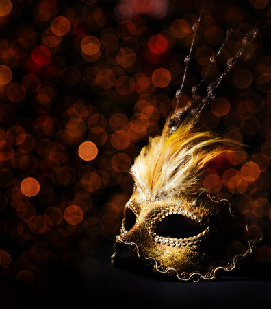carnival masks: Golden venetian mask over black background