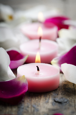 Spa candles and rose petals.  photo