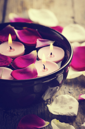 candles spa: Spa candles and rose petals. Stock Photo
