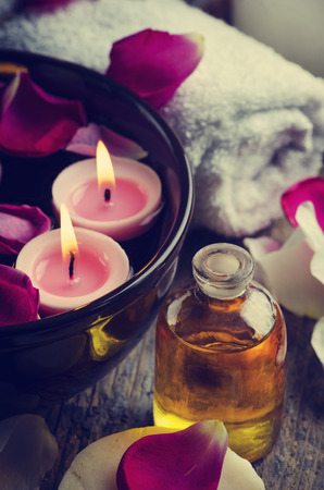 beauty treatment salon: Spa candles and massage oil.