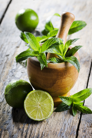 woden: Mojito ingredients on rustic wooden table