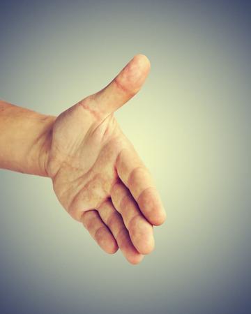 Man giving his hand for handshake photo