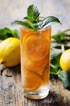 Refreshing ice tea with lemon and mint