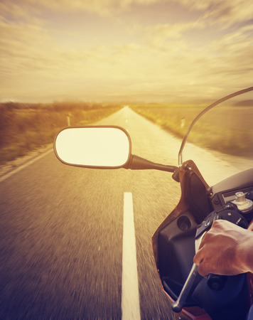 Motorcycle driving on highway 스톡 콘텐츠