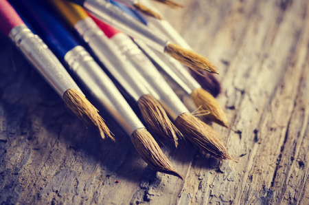 Paint brushes on rustic wooden table