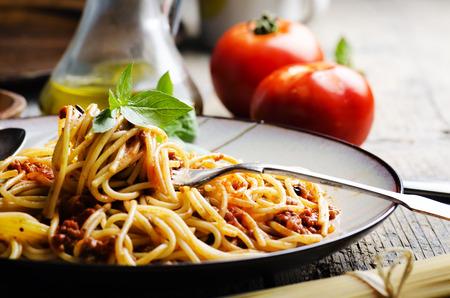pasta dish: Italian spaghetti on rustic wooden table