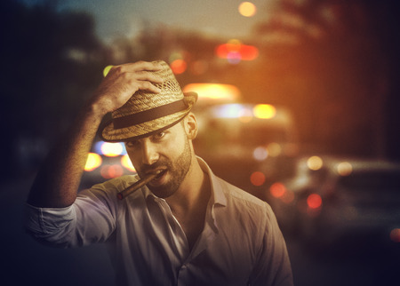 Handsome man with cuban cigar on the street photo