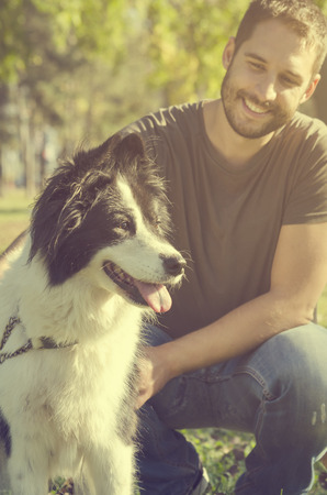 Man with his dog playing in the park Stock Photo