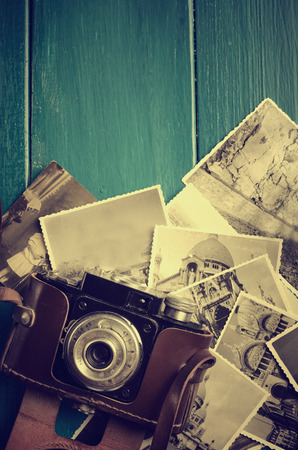 photo album background: Vintage photo camera and old photos.